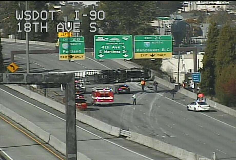 All lanes of westbound Interstate 90 were blocked Tuesday afternoon after a semi truck rollover near the Interstate 5 interchange. Photo: Courtesy WSDOT