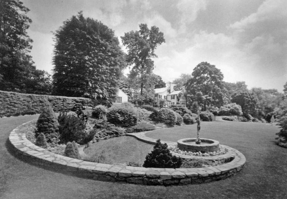 The fountain, gardens and greenery of the Heath Estate, 124 Doubling Road, shield the main house from the May heat of 1991. The home sold for $9,850,000 two years later, in 1993. Photo: Paul Desmarais / Paul Desmarais / Greenwich Time