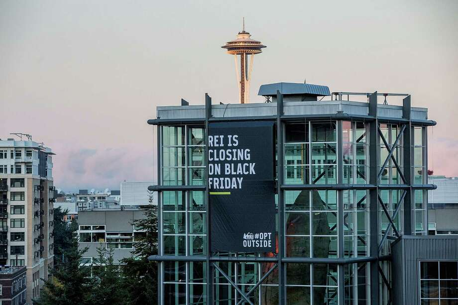 Specialty Outdoor Retailer REI announces it will close 143 stores on Black Friday this year. Pictured, the chain's Seattle flagship store. Photo: Suzi Pratt / Suzi Pratt / Getty Images For REI / 2015 Getty Images