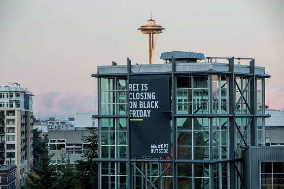 Specialty Outdoor Retailer REI announces it will close 143 stores on Black Friday this year. Pictured, the chain's Seattle flagship store.