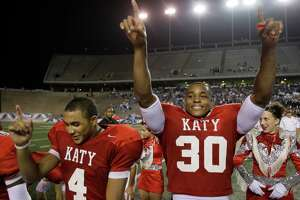 Aundre Dean (30) celebrates Katy's 42-0 win over  Clements High School in Division I Region III 5A finals at Rice University   Dec. 8, 2007