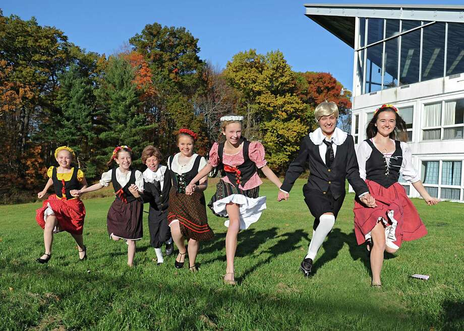 """Students playing the Von Trapp children, from left, Ella Smith, Sophia Adam, Ryan McMahon, Anna Smith, Maggie Hayes. Julia Tronco and Elizabeth Hanchar run outside the auditorium where they will be performing """"The Sound of Music"""" at Academy of the Holy Names on Monday, Oct. 26, 2015 in Albany, N.Y. World-renowned tenor Ronan Tynan will be playing a cameo role in the play. (Lori Van Buren / Times Union) Photo: Lori Van Buren / 10033928A"""
