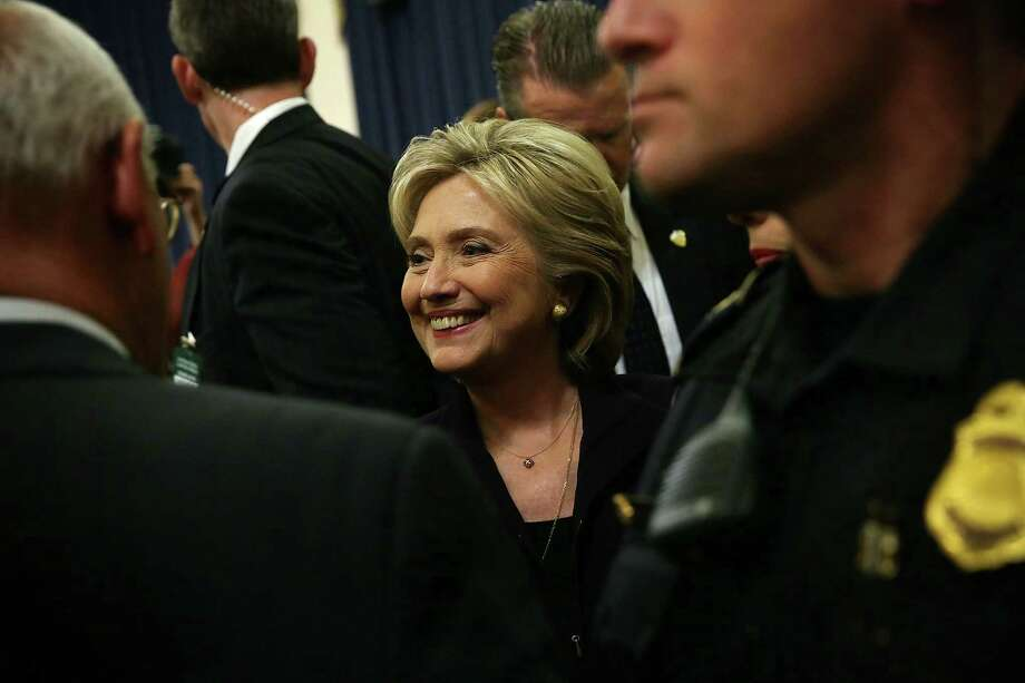 Fformer Secretary of State Hillary Clinton smile after 11 hours to testimony House Select Committee on Benghazi. A reader criticizes her appearance before the committee. Photo: Alex Wong /Getty Images / 2015 Getty Images