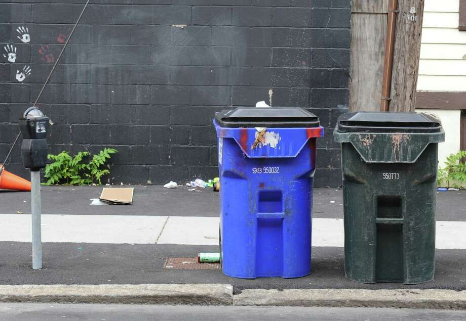 Trash cans are places by the curb near Central Ave. on Thursday, Oct. 1, 2015 in Albany, N.Y. (Lori Van Buren / Times Union) Photo: Lori Van Buren / 10033588A
