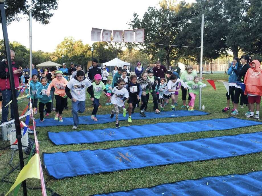 More than 150 people cross the starting line during Friendswoodé­s 2014 Flapjack Fun Run. Sponsorships for this yearé­s event are available. Photo: City Of Friendswood