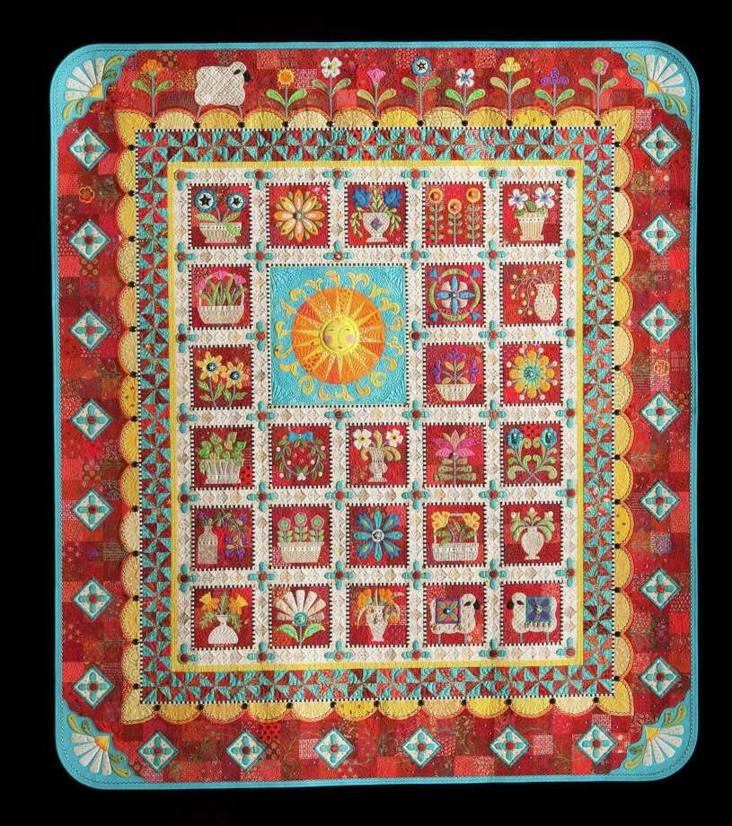 """""""Ewe Are My Sunshine"""" by Janet Stone of Overland Park, Kan., is winner of the $10,000 Handi Quilter Best of Show award at the 2015 International Quilt Festival Houston. Photo: International Quilt Association"""