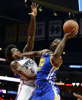 LOS ANGELES CA - OCTOBER 20: Harrison Barnes #40 of the Golden State Warriors goes for a layup against DeAndre Jordan #6 of the Los Angeles Clippers during the first quarter of the pre-season basketball game at Staples Center October 20, 2015 in Los Angeles, California. NOTE TO USER: User expressly acknowledges and agrees that, by downloading and or using this Photograph, user is consenting to the terms and condition of the Getty Images License Agreement. (Photo by Kevork Djansezian/Getty Images)