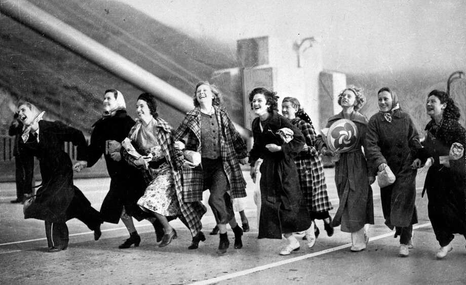 Nine students from San Rafael High School cross the Golden Gate Bridge on opening day, May 23, 1937. / ONLINE_YES