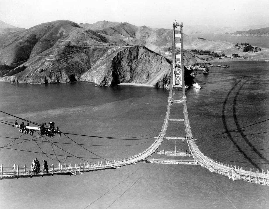Workers complete the catwalks for the Golden Gate Bridge, Oct. 25, 1935. Photo: ASSOCIATED PRESS / AP1935