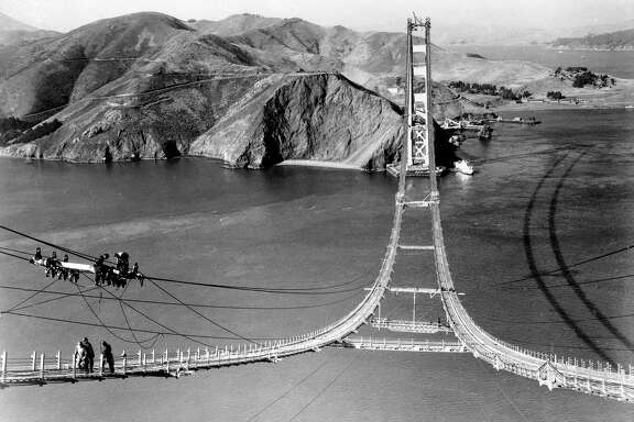 Workers complete the catwalks for the Golden Gate Bridge, Oct. 25, 1935.
