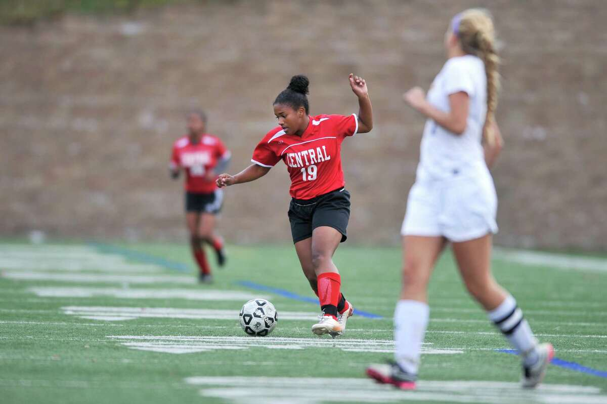 Bridgeport Central junior Selena Lopes weaves through Westhill's defense during a varsity girls soccer game at Westhill High School on Tuesday afternoon, Oct. 27, 2015.