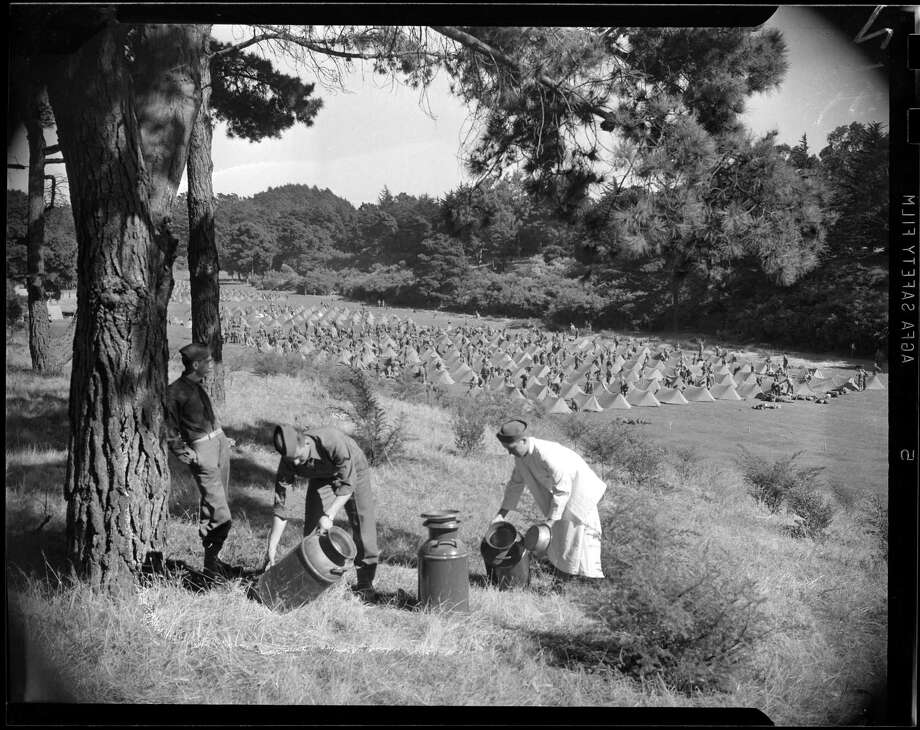 Three soldiers from Fort Ord stationed in Golden Gate Park are shown cleaning pots in October 1941. Photo: Bob Campbell / Bob Campbell / SFC / CHRONICLE