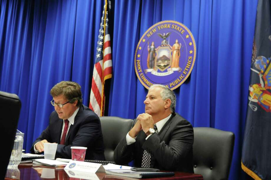 Joint Commission on Public Ethics chair Daniel J. Horowitz, left, and commission member Michael A. Romeo, right, sit at the head of the table during a JCOPE meeting Tuesday morning, Oct. 27, 2015, in Albany, N.Y. (Will Waldron/Times Union) Photo: Will Waldron / 00033954A