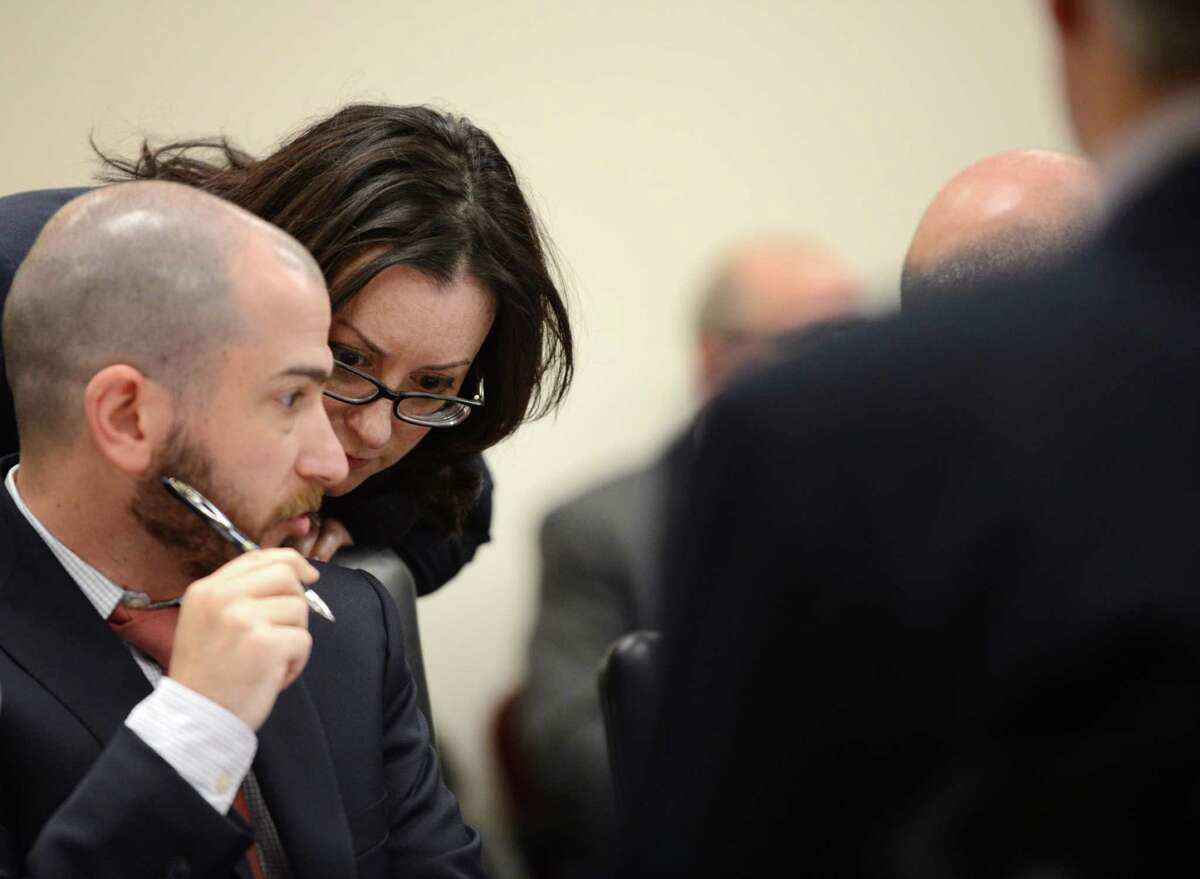 Joint Commission on Public Ethics Commission general counsel, Monica Stamm, right, speaks to Martin Levine, director of JCOPE?'s statutory filings and audit functions, left, during a JCOPE meeting Tuesday morning, Oct. 27, 2015, in Albany, N.Y. (Will Waldron/Times Union)