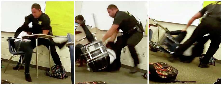 This three image combo made from video taken by a Spring Valley High School student on Monday, Oct, 26, 2015, shows Senior Deputy Ben Fields trying to forcibly remove a student from her chair after she refused to leave her high school math class, in Columbia S.C. The Justice Department opened a civil rights investigation Tuesday after Fields flipped the student backward in her desk and tossed her across the floor. (AP Photo) ORG XMIT: AZX604 / Student