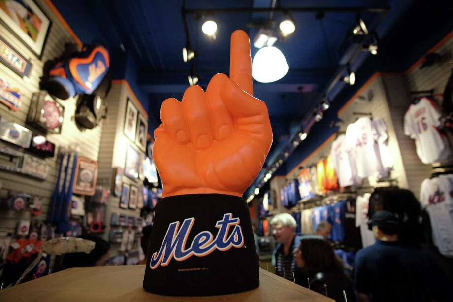 Fans browse through different items at a Mets' memorabilia store in New York on October 27, 2015. After decades of failure, the butt of jokes everywhere, the Mets have achieved the unimaginable: a spot in the World Series 30 years after they last clinched the title in 1986. AFP PHOTO/JEWEL SAMADJEWEL SAMAD/AFP/Getty Images Photo: JEWEL SAMAD / AFP