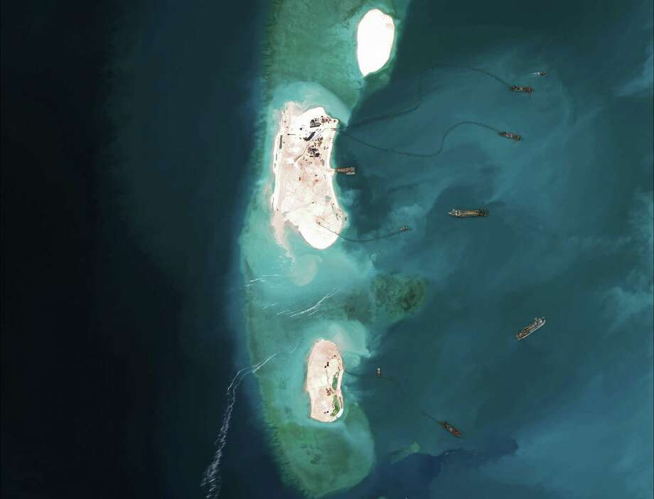 A handout satellite image from March 16, 2015 of dredgers at the northernmost reclamation site of Mischief Reef, part of the Spratly Islands in the South China Sea. The U.S. has been briefing allies in Asia on plans to conduct naval patrols near disputed artificial islands built by China, a move that could escalate tensions with Beijing. (CSIS's Asia Maritime Transparency Initiative via The New York Times.) -- NO SALES; FOR EDITORIAL USE ONLY WITH STORY SLUGGED US CHINA SEA  BY PERLEZ AND HERNANDEZ. ALL OTHER USE PROHIBITED. ORG XMIT: XNYT101 Photo: CSIS'S ASIA MARITIME TRANSPARENCY INITIATIVE / CSIS'S ASIA MARITIME TRANSPARENCY INITIATIVE