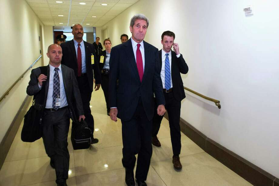 Secretary of State John Kerry leaves the Capitol in Washington, Tuesday, Oct. 27, 2015, after briefing the Senate Foreign Relations Committee on the Administration's response to the Syrian conflict, in a closed session. (AP Photo/Cliff Owen) ORG XMIT: DCCO109 Photo: Cliff Owen / FR170079 AP