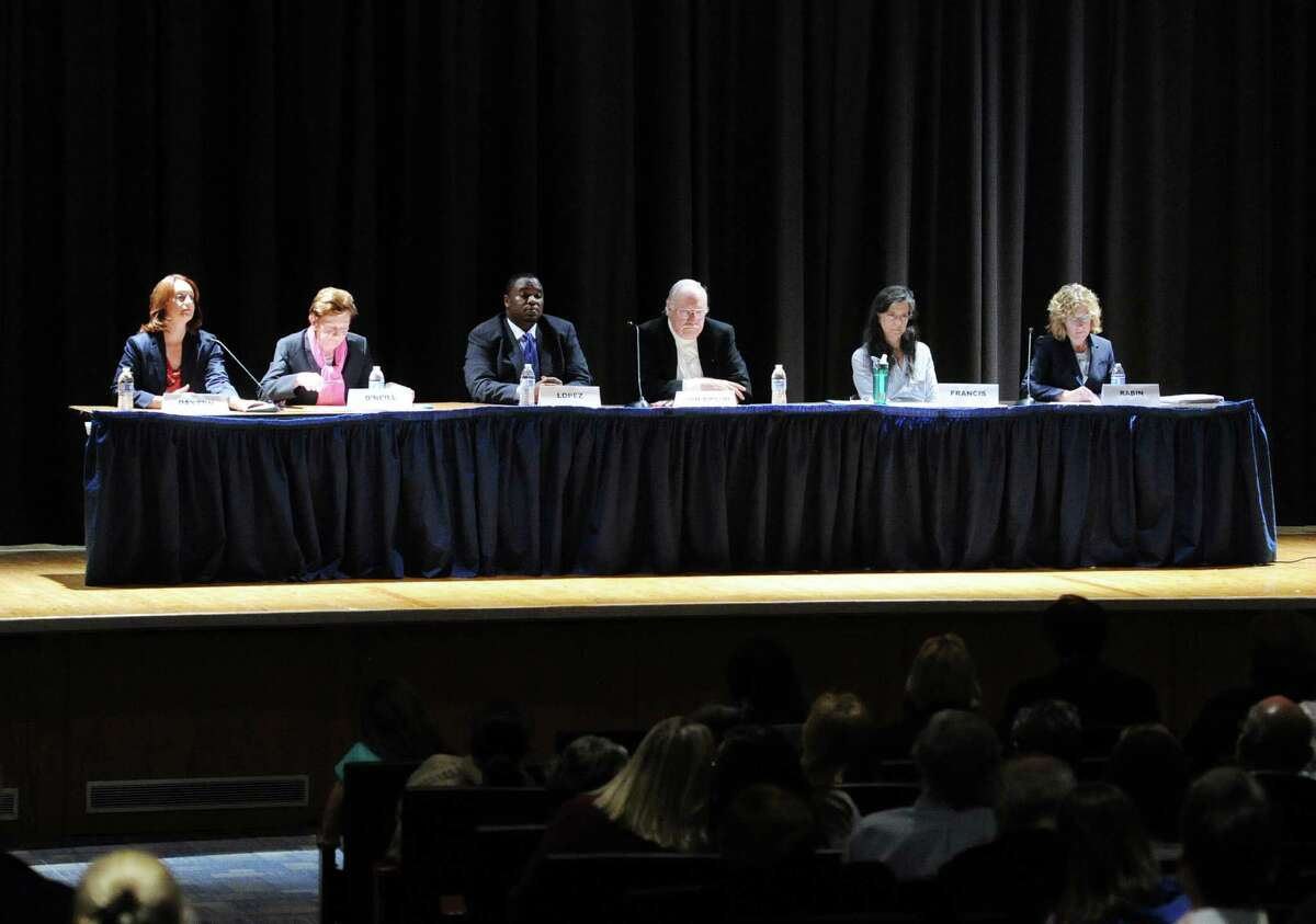 Scool board candidates, from left, Jennifer Dayton, a Democratic incumbent, Barbara O'Neill, a Republican incumbent, Anthony Lopez, a Democrat, Peter Von Braun, a Republican incumbent, Gaetane Francis, a Democrat, and Lauren Rabin, a Republican, during Tuesday's candidates forum at Central Middle School.