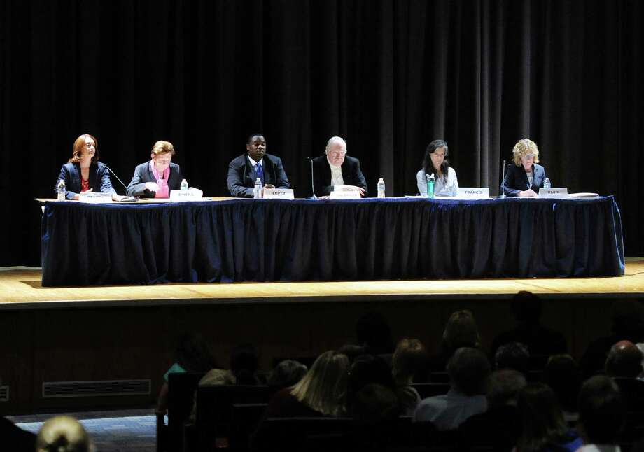 Scool board candidates, from left, Jennifer Dayton, a Democratic incumbent, Barbara O'Neill, a Republican incumbent, Anthony Lopez, a Democrat, Peter Von Braun, a Republican incumbent, Gaetane Francis, a Democrat, and Lauren Rabin, a Republican, during Tuesday's candidates forum at Central Middle School. Photo: Bob Luckey Jr. / Hearst Connecticut Media / Greenwich Time