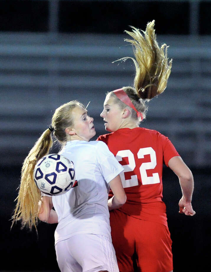 New Canaan's Alejandra Deambrosio (#22), left, goes for the ball as does Katherine Gallagher (#22) of Greenwich during the high school soccer match between New Canaan High School and Greenwich High School at New Canaan, Conn., Tuesday night, Oct. 27, 2015. Photo: Bob Luckey Jr. / Hearst Connecticut Media / Greenwich Time
