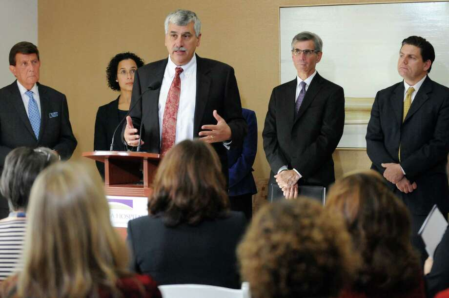 Angelo Calbone, president and CEO of Saratoga Hospital, center, announces a partnership with Albany Medical Center on Tuesday, Oct. 27, 2015, at Saratoga Hospital in Saratoga Springs, N.Y. Joining him, from left, are James J. Barba, president and CEO of Albany Medical Center; Dr. Renee Rodriquez-Goodemoote, president of Saratoga Hospital medical staff; Robert Cushing, chairman of Albany Medical Center board of directors; and Dr. Joseph Bell, chair of Saratoga Regional Medical Group. (Cindy Schultz / Times Union) Photo: Cindy Schultz / 00033948A