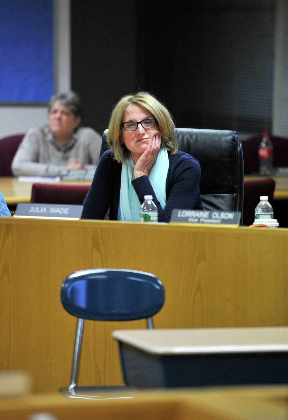 Stamford Board of Education member Julia Wade listens to Cort Wrotnowski appeal to the board for her dismissal on Tuesday night, Oct. 27, 2015. With Mr. Wrotnowski were several signs calling for Ms. Wade's resignation.