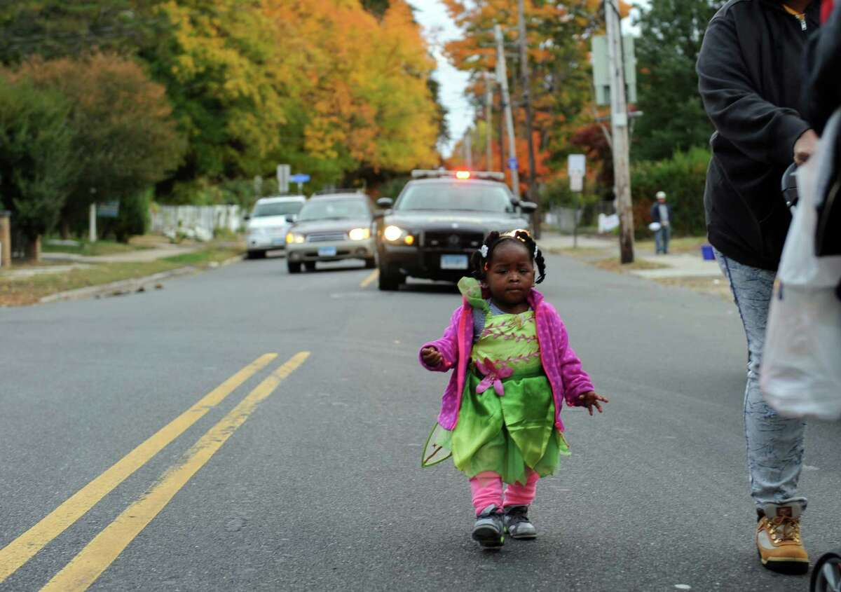 Destiny Clarke, 1, takes part in the Halloween parade along Ellsworth Street in the Black Rock section of Bridgeport, Conn. on Tuesday October 27, 2015. The parade ended at the Black Rock Branch of the Bridgeport Public Library where kids could enjoy scary stories, food and even goodie bags.
