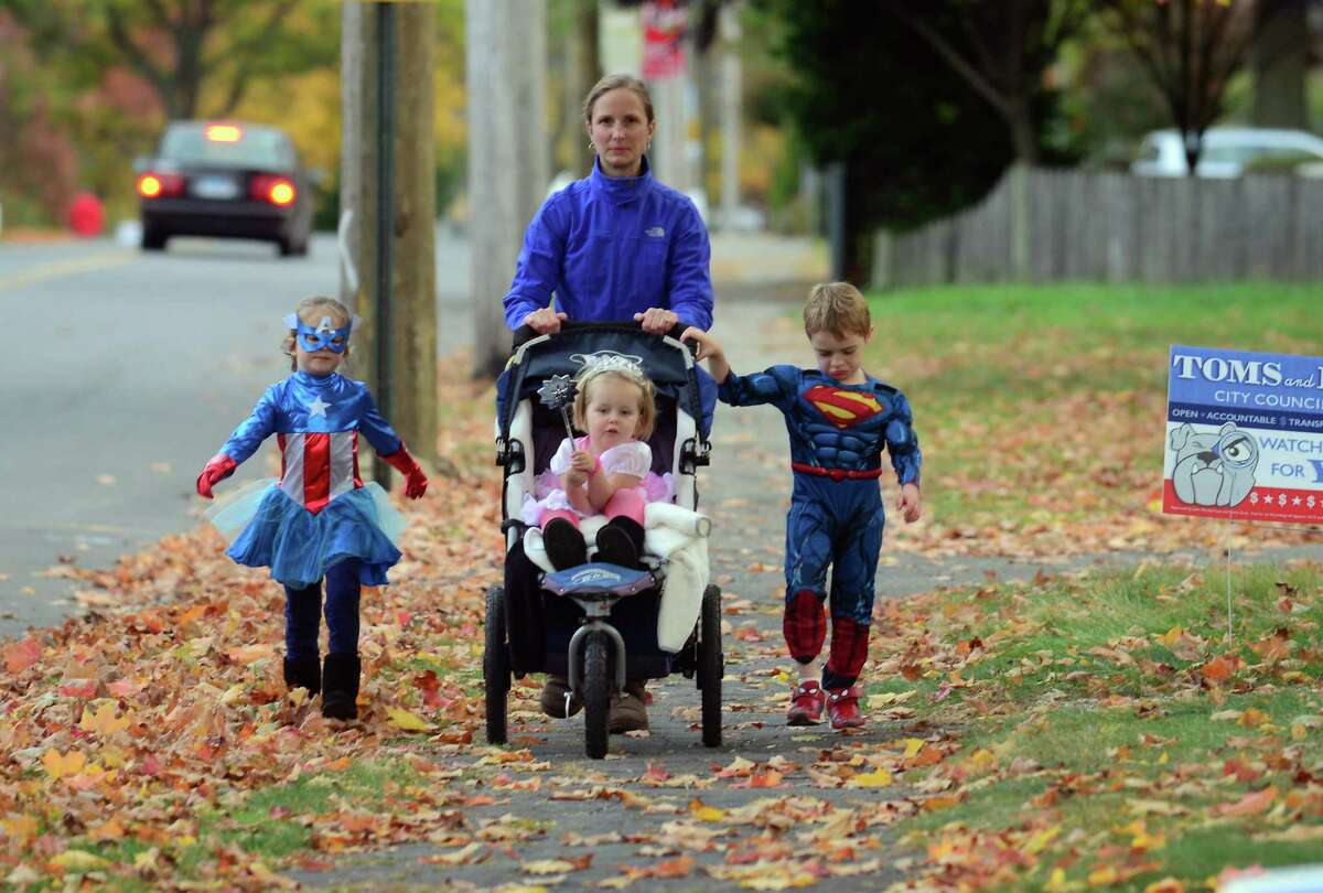 Families and children take part in the traditional Halloween parade along Ellsworth Street in the Black Rock section of Bridgeport, Conn. on Tuesday October 27, 2015. The parade ended at the Black Rock Branch of the Bridgeport Public Library where kids could enjoy scary stories, food and even goodie bags.
