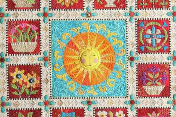 """""""Ewe Are My Sunshine"""" by Janet Stone of Overland Park, Kan., is winner of the $10,000 Handi Quilter Best of Show award at the 2015 International Quilt Festival Houston."""