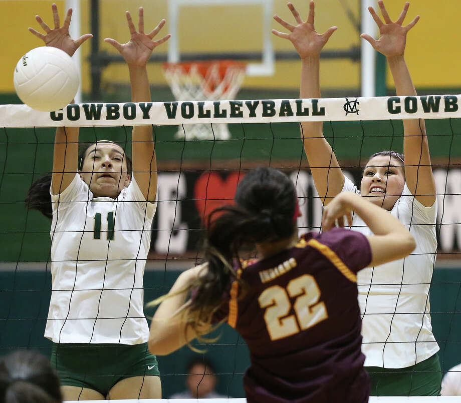 Victoria Yzaguirre puts the prevent on a shot by Hailey Rinewalt as her McCollum Cowboys host Harlandale in a District 28-5A high school volleyball match at the McCollum gym on Oct. 27. Yzaguirre was selected to play on the district's first team. Photo: Tom Reel /San Antonio Express-News