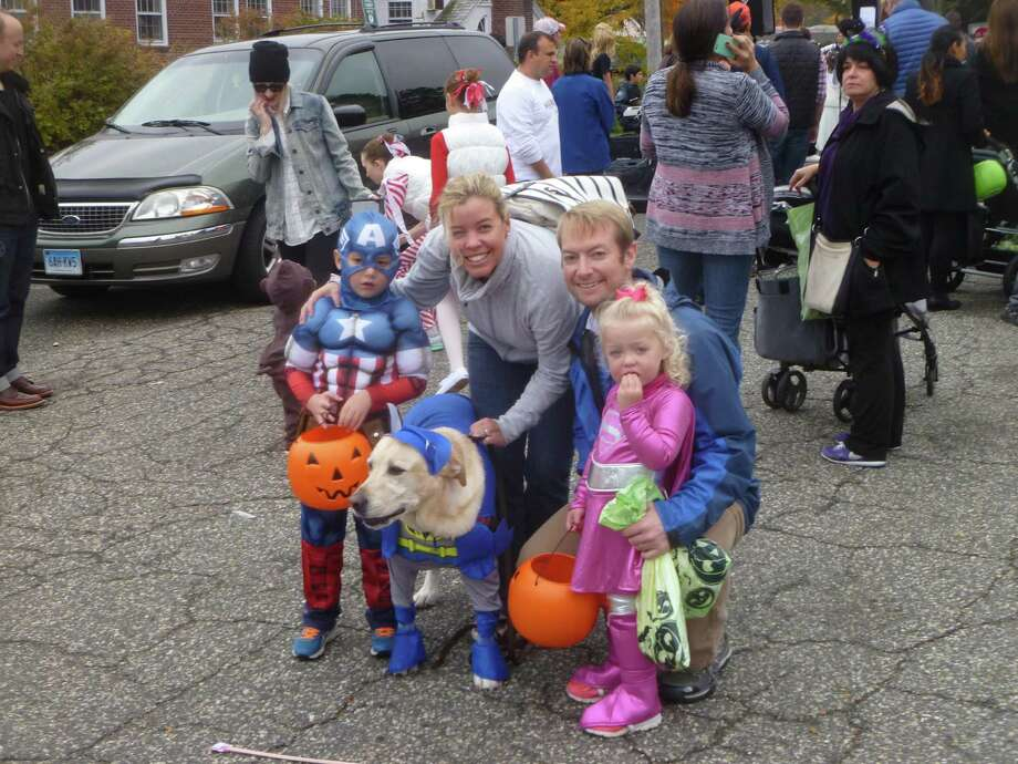 From left to right, Topher Kern dressed as Captain America, Kerry Kern, Greg Kern, and Taylor Kern, dressed as Supergirl at New Canaan's 34th Annual Halloween Parade. Photo: Martin Cassidy / Hearst Connecticut Media / New Canaan News