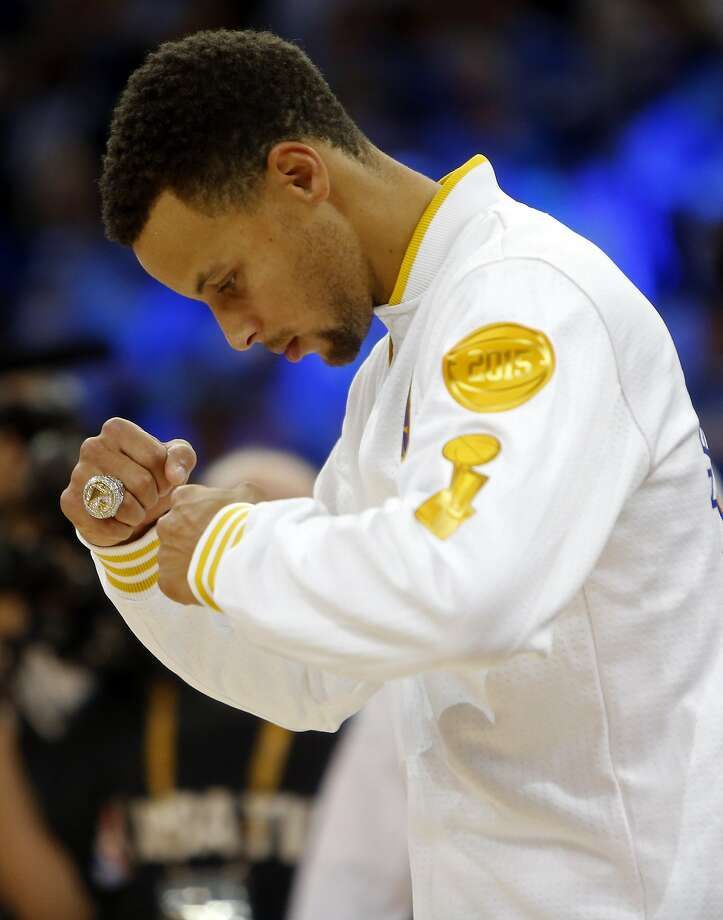 Golden State Warriors' Stephen Curry enjoys his NBA Championship ring after ceremony before playing New Orleans Pelicans during NBA game at Oracle Arena in Oakland, Calif., on Tuesday, October 27, 2015. Photo: Scott Strazzante, The Chronicle