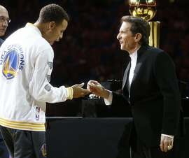 Golden State Warriors' owner Peter Guber presents Stephen Curry his 2015 NBA Championship ring before playing New Orleans Pelicans during NBA game at Oracle Arena in Oakland, Calif., on Tuesday, October 27, 2015.