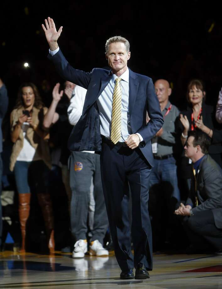 Golden State Warriors' head coach Steve Kerr is introduced before receiving his 2015 NBA Championship ring before playing New Orleans Pelicans during NBA game at Oracle Arena in Oakland, Calif., on Tuesday, October 27, 2015. Photo: Scott Strazzante, The Chronicle