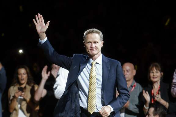 Golden State Warriors' head coach Steve Kerr is introduced before receiving his 2015 NBA Championship ring before playing New Orleans Pelicans during NBA game at Oracle Arena in Oakland, Calif., on Tuesday, October 27, 2015.