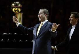 Golden State Warriors' owners Joe Lacob (left) and Peter Guber enjoy handing out 2015 NBA Championship rings before Warriors played the New Orleans Pelicans during NBA game at Oracle Arena in Oakland, Calif., on Tuesday, October 27, 2015.