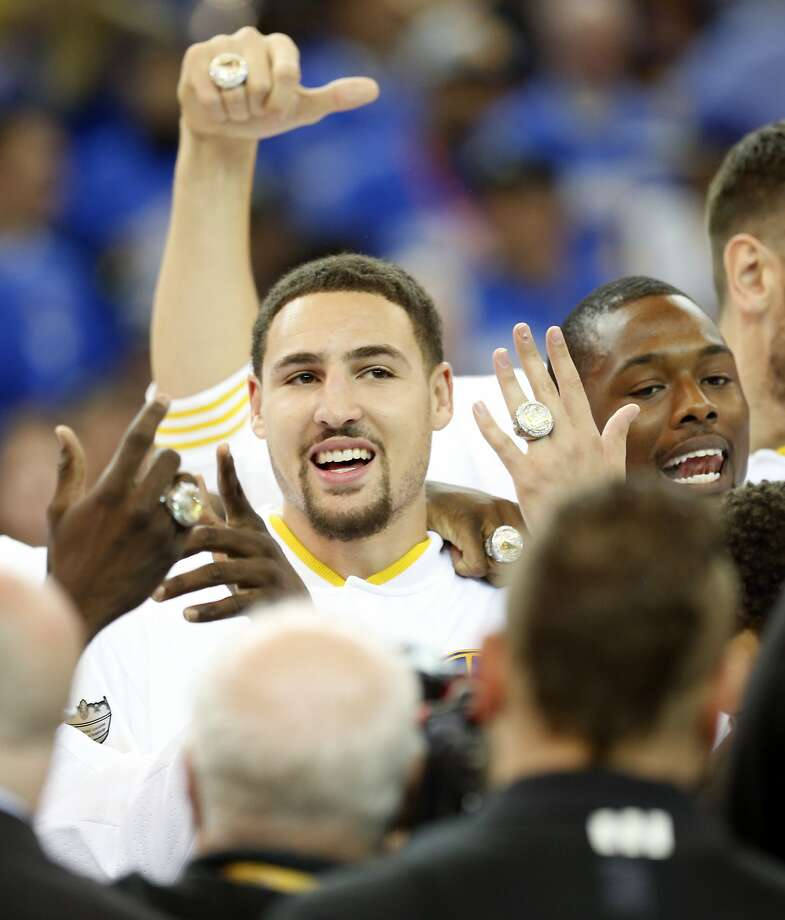 Golden State Warriors' Klay Thompson and Harrison Barnes show off their NBA Championship ring after ceremony before playing New Orleans Pelicans during NBA game at Oracle Arena in Oakland, Calif., on Tuesday, October 27, 2015. Photo: Scott Strazzante, The Chronicle