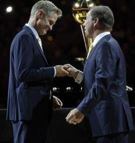 Golden State Warriors' owners Joe Lacob presents head coach Steve Kerr with his 2015 NBA Championship ring before playing New Orleans Pelicans during NBA game at Oracle Arena in Oakland, Calif., on Tuesday, October 27, 2015.