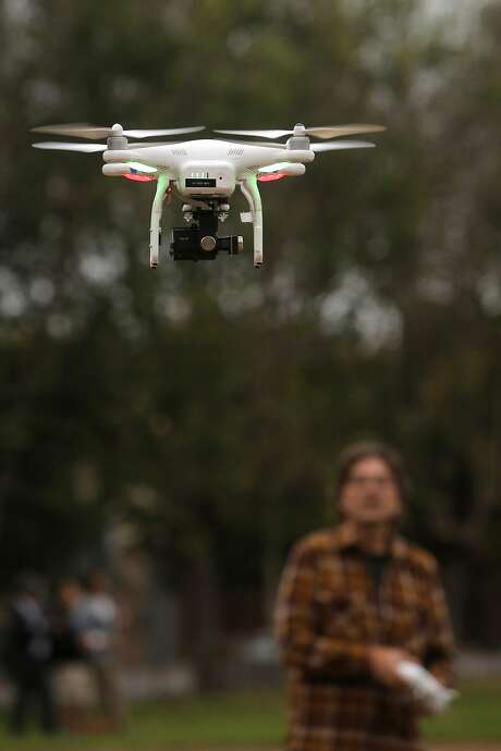 Student David Golden, (right) of San Francisco takes his first flight during a drone flying workshop at Jackson Park  in San Francisco, Calif. on Tues. October 27, 2015. The workshop is being put on by the company Lumoid who rents consumer electronic gadgets including drones. Photo: Michael Macor, The Chronicle