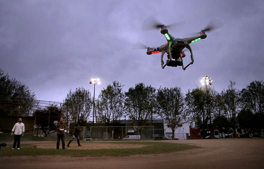 Students take their first flights during a drone flying workshop at Jackson Park in San Francisco, Calif. on Tues. October 27, 2015. The workshop is being put on by the company Lumoid who rents consumer electronic gadgets including drones. Photo: Michael Macor, The Chronicle