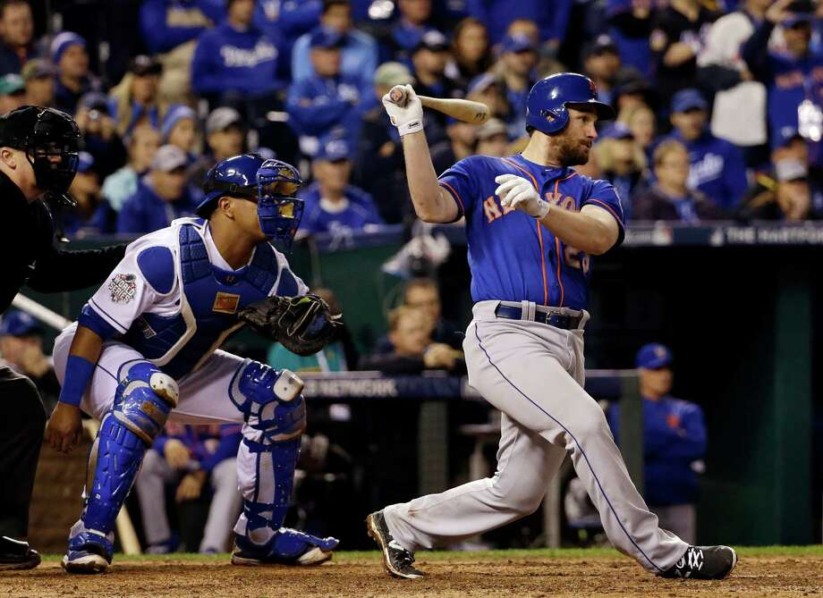 New York Mets' Daniel Murphy hits a single during the seventh inning of Game 1 of the Major League Baseball World Series against the Kansas City Royals Tuesday, Oct. 27, 2015, in Kansas City, Mo. (AP Photo/David J. Phillip) ORG XMIT: WS540 Photo: David J. Phillip / AP
