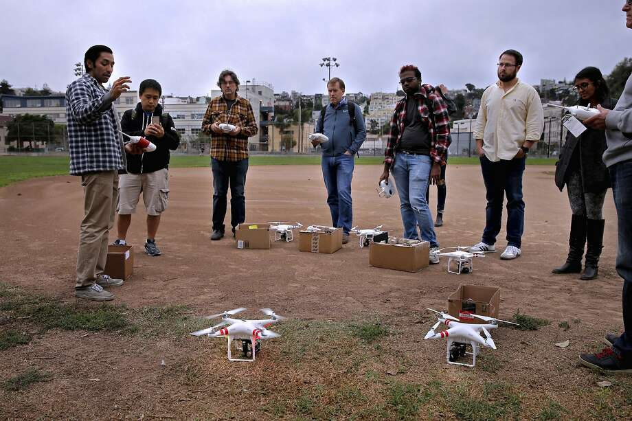Instructor, Yash Patel, (left) gives out pre-flight instructions to students during a drone flying workshop at Jackson Park in San Francisco, Calif. on Tues. October 27, 2015. The workshop is being put on by the company Lumoid who rents consumer electronic gadgets including drones. Photo: Michael Macor, The Chronicle
