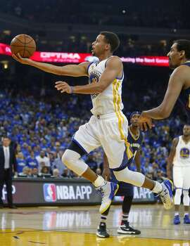 Golden State Warriors' Stephen Curry scores in 1st quarter against New Orleans Pelicans during NBA game at Oracle Arena in Oakland, Calif., on Tuesday, October 27, 2015.