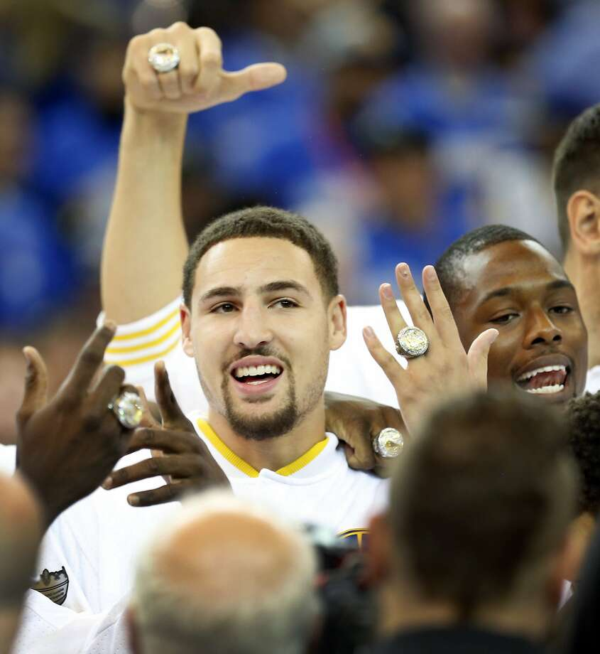 40d2cdaf9269 Golden State Warriors  Klay Thompson and Harrison Barnes show off their NBA  Championship ring after