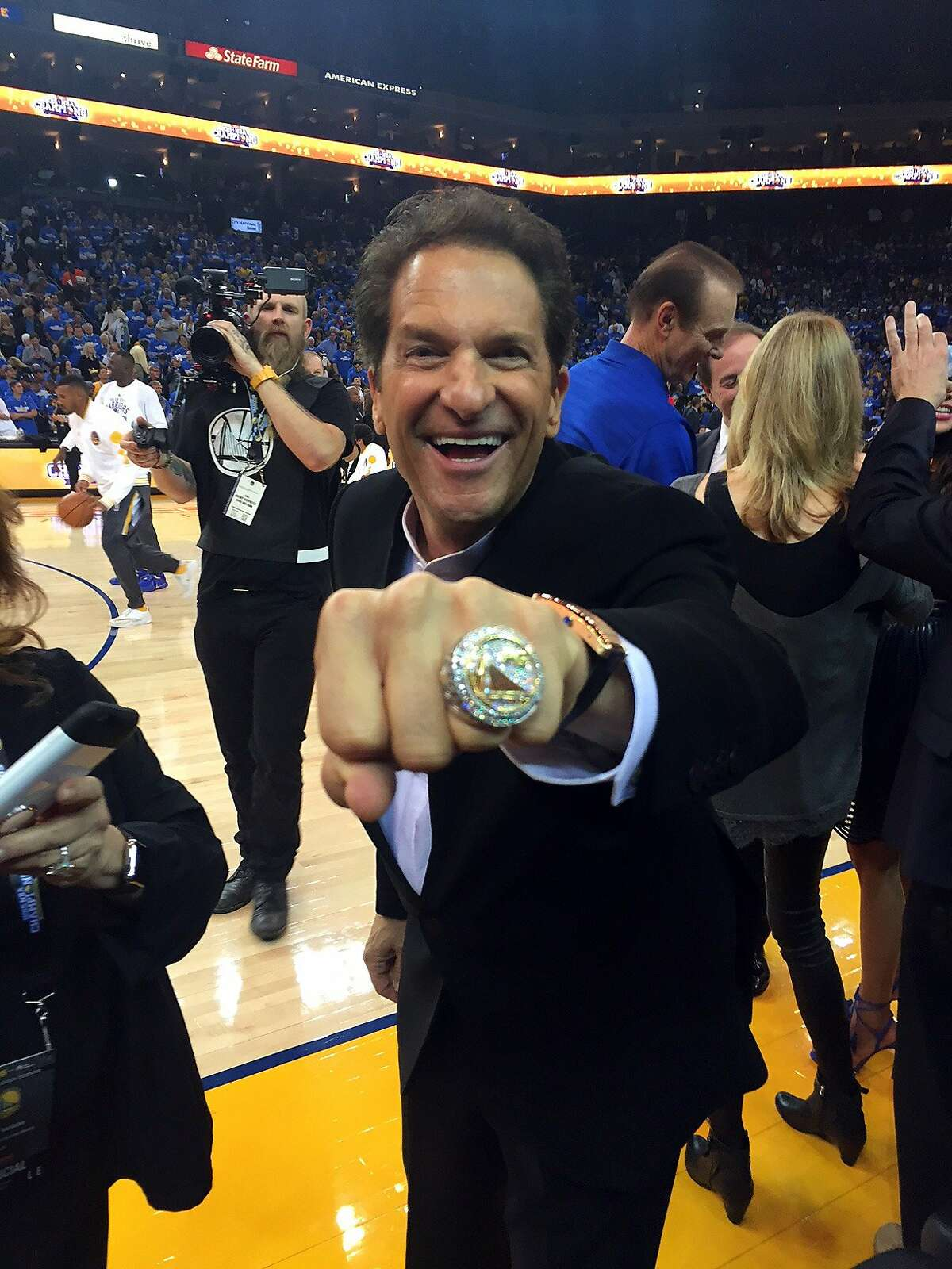 Peter Guber shows off his NBA Championship ring after the ceremony before playing New Orleans Pelicans during NBA game at Oracle Arena in Oakland, Calif., on Tuesday, October 27, 2015.
