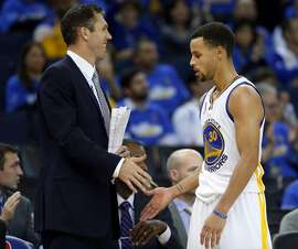 Golden State Warriors' interim coach Luke Walton shakes hands with Stephen Curry late in 4th quarter of iWarriors' 111-95 win over New Orleans Pelicans during NBA game at Oracle Arena in Oakland, Calif., on Tuesday, October 27, 2015.