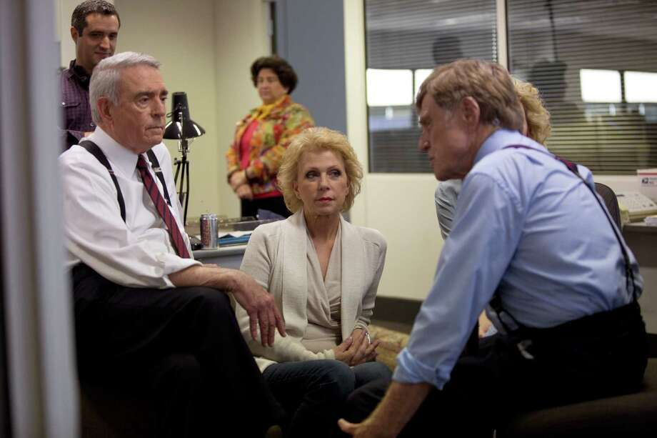 """Former news anchor Dan Rather, left, """"60 Minutes"""" producer Mary Mapes and actor Robert Redford discuss how to approach the filming of a scene on the set of """"Truth."""" Photo: Lisa Tomasetti, HONS / Sony Pictures Classics"""