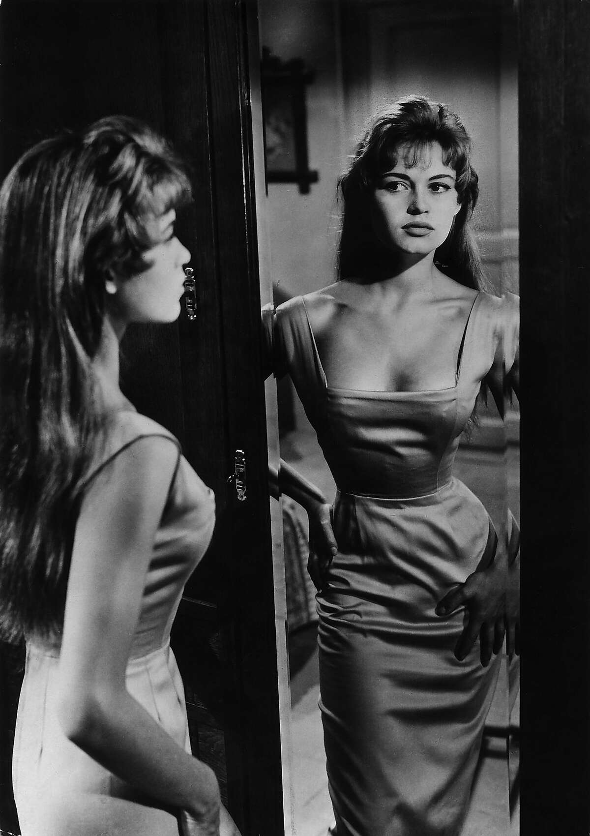 A young wife (Brigitte Bardot) conflicted by her husband's protracted illness readies herself for having an affair that has serious consequences in Georges Lacombe's THE LIGHT ACROSS THE STREET (1955).