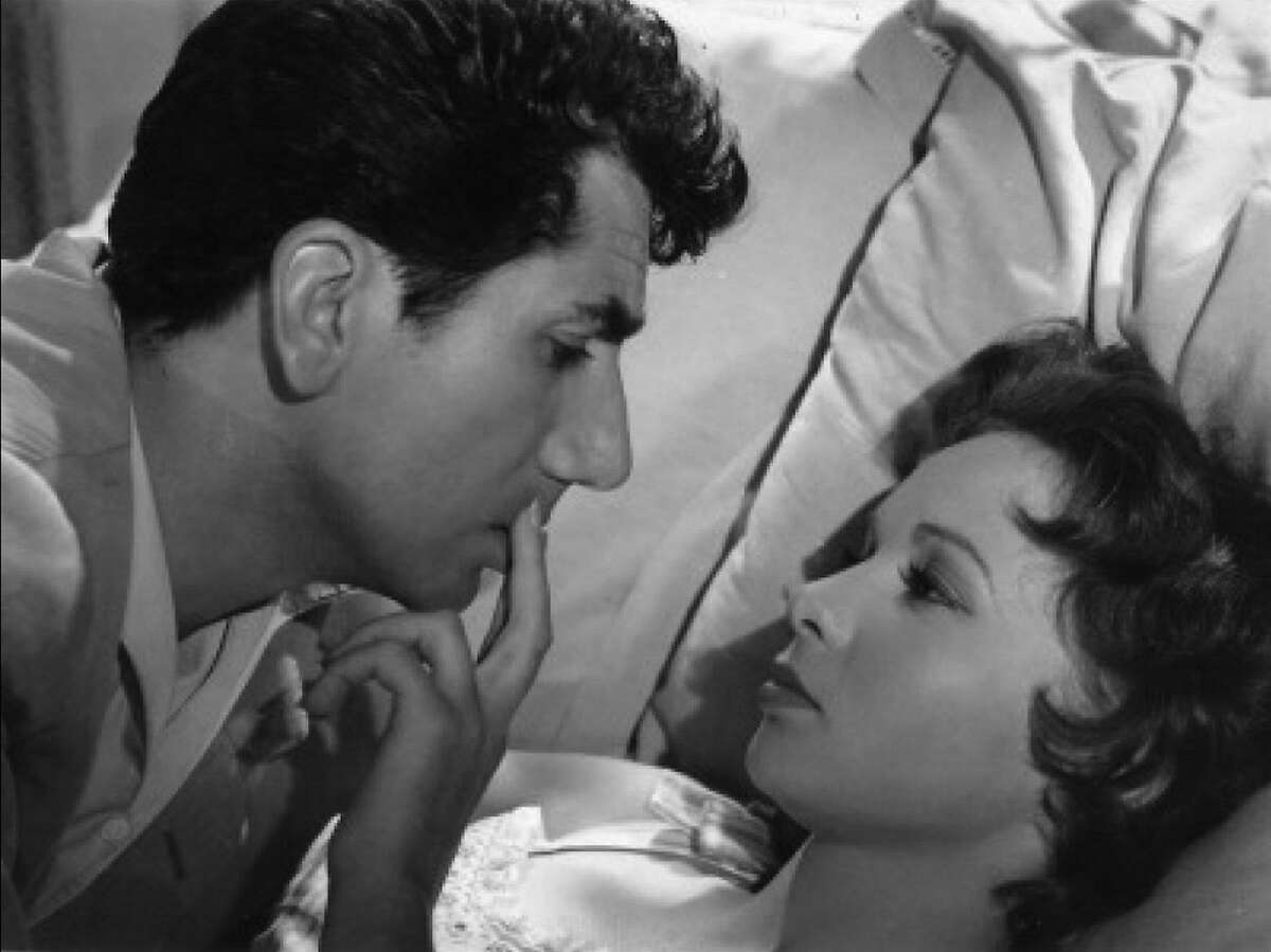 A haunted ex-soldier (Daniel Gelin) and a mysterious widow (Francoise Arnoul) try to prevent their past secrets from destroying their love in Henri Verneuil's THE LOVERS OF LISBON (1955).